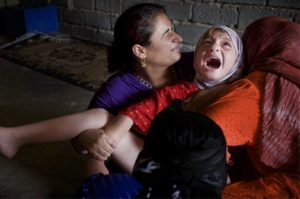 A young Muslim girl screams as her clitoris is forcibly cut away.