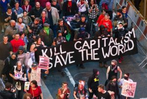 Members from the Occupy Wall Street movement carry signs and banners as they march down Broadway during a May Day demonstration in New York, May 1, 2012. REUTERS/Lucas Jackson (UNITED STATES - Tags: CIVIL UNREST BUSINESS POLITICS) - RTR31HF2
